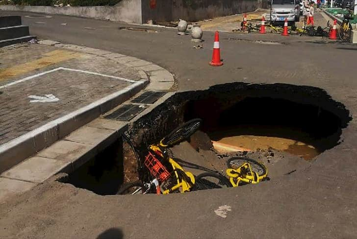 bicycles-in-sinkhole