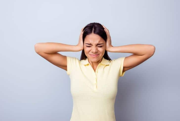 woman-holding-ears-noise-pollution