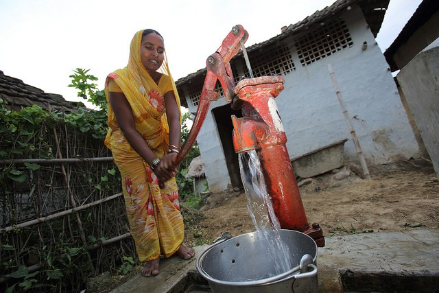woman-draws-water-from-tubewell-groundwater-depletion