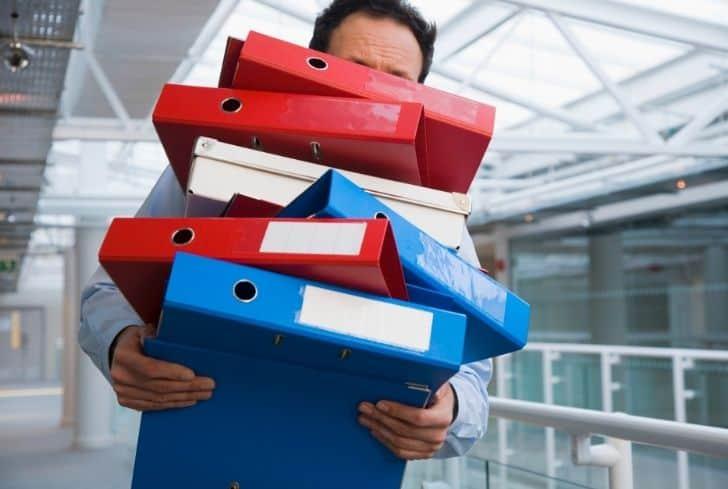 man-carrying-binders